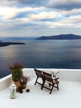 Santorini Greece lounge chairs with sea view