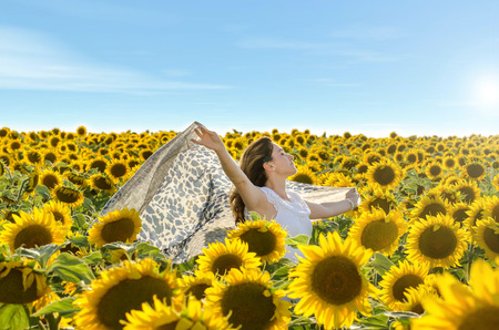 only young adults: Girl outdoors in spring sunflower field