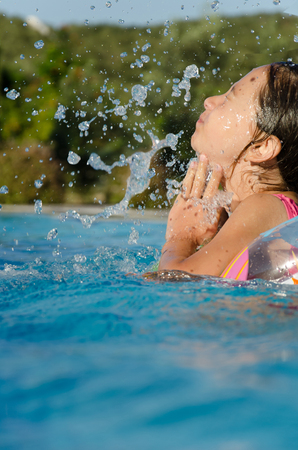 english ethnicity: Girl in swimming-pool
