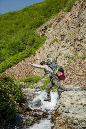 only one mid adult male: Hiker jumping