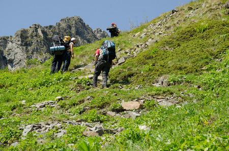 english ethnicity: Hiking to the summit Stock Photo