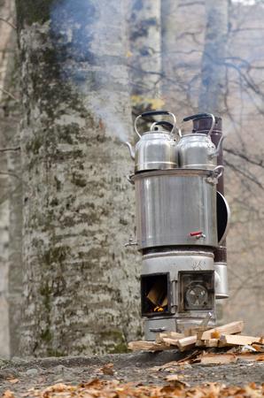 samovar: Steaming samovar in the forest Stock Photo