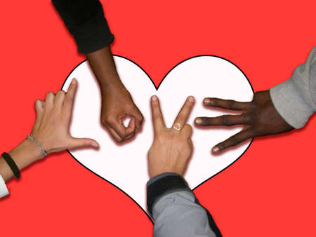 Love created from posed  multicultural hands over a heart Imagens - 2246098