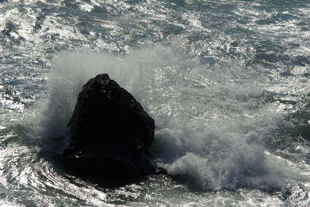 wild wave hit rock Stock Photo