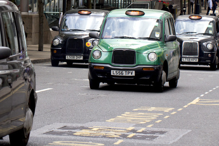 taxi sign: London Taxi Cabs in Canary Wharf Editorial