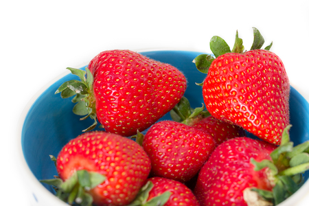 A bowl of juicy, ripe strawberries (Fragaria × ananassa)