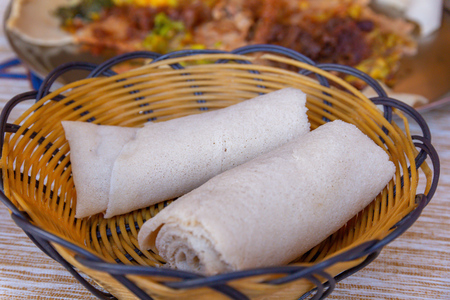Rolls of Injera in a serving bowl.  Injera is a sourdough flatbread made from teff flour.  It is the national dish of Ethiopia, Eritrea, Somalia and Djibouti Stok Fotoğraf