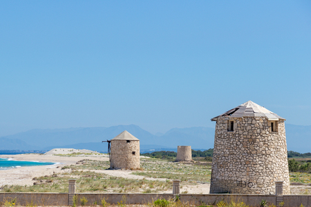 Ancient windmills on Agios Ioannis beach, Lefkada, Greece