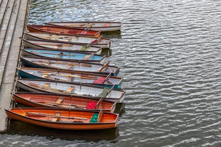 Wooden boats for hire moored on the River Thames, UK
