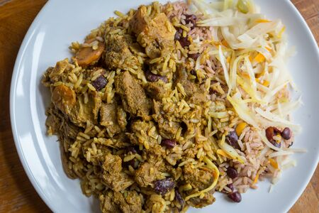 Jamaican Curried Goat served with traditional rice and peas