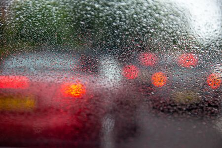 Driving with heavy rain on car windscreen and poor visibility.