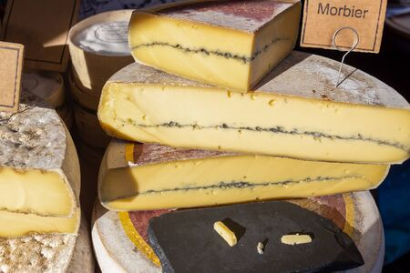 Morbier cheese on display on a UK food market stall