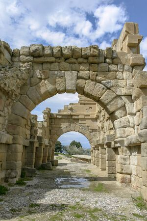 Stone arch structures of the ancient town of Tindari, formerly Tyndaris, Patti, Messina, Sicily, Italy