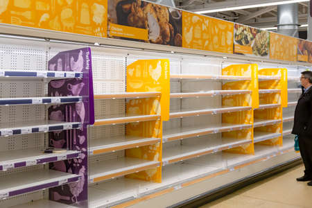 London, England - March 17 2020: Empty supermarket shelves as a result of Covid-19, Coronavirus, pandemic induced bulk buying