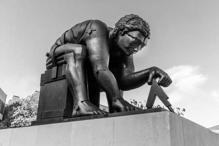 London, United Kingdom, October 18 2019 - Black and white image of Newton, After William Blake on the concourse of the British Library, London - a 1995 Sir Eduardo Paolozzi bronze sculpture of Sir Isaac Newton, based on a William Blake print called Newton
