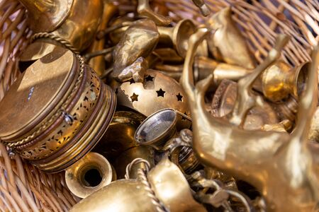 Close up of an assortment of brass collectible objects