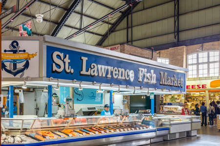 Toronto, Canada - August 22 2018: St Lawrence Fish Market fishmonger in the South building of St Lawrence Market selling fresh seafood in downtown Toronto, Ontario, Canada