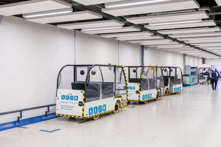 Gatwick Airport, Crawley, England - August 14 2018: Fleet of electric vehicles at Gatwick airport, used to transport passengers, luggage and manoeuvre trolleys Redakční