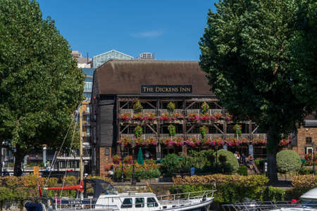 London, United Kingdom - August 01, 2018: The Dickens Inn pub and restaurant at St Katharine Dock is a picturesque restyled and reconstructed 18th century former brewery Redakční