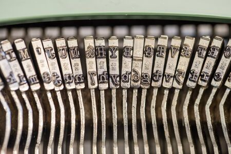 Close up of old fashioned vintage typewriter typebars