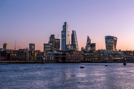 Sunrise view of London skyline and skyscrapers, from across the River Thames Reklamní fotografie