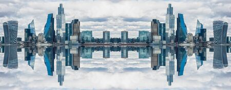 Double horizontal and vertical mirror effect of London, UK city skyline and skyscrapers