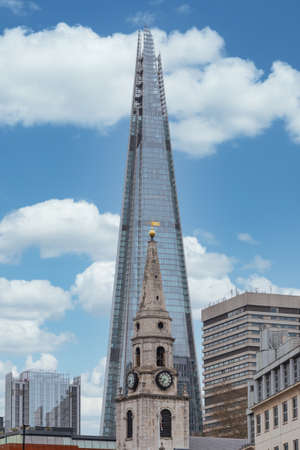 London, England - April 02, 2020: St. George the Martyr church, with the Shard building in the background, on Borough High St in Southwark, London, England Redakční