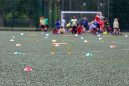 Children competing during school sports day in the UK. Blurred image with selective focus.