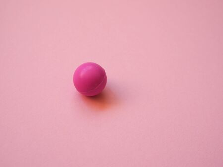 little pink ball shape lies on the table