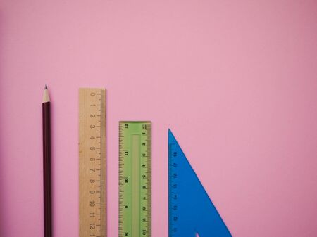 school supplies on a light background. back to school. Rulers and pencils