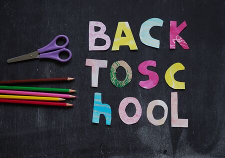 the writing paper back to school on chalk blackboard background Stock fotó