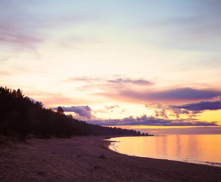 beautiful sunset over the sea lake water shore with forest Stock fotó