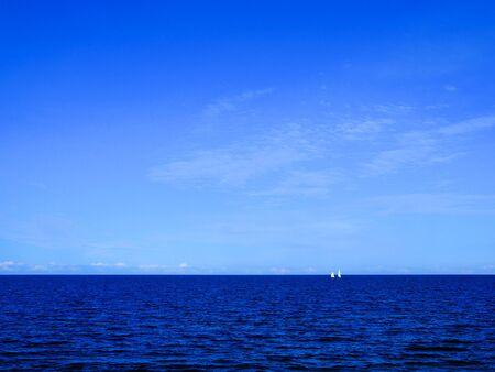 blue sea and sky and small sailboats on it background Zdjęcie Seryjne