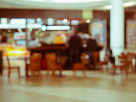 blurred view of the cafe with people