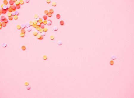 colorful confetti scattered on a light background