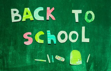 the writing paper back to school on chalk blackboard background Stock Photo