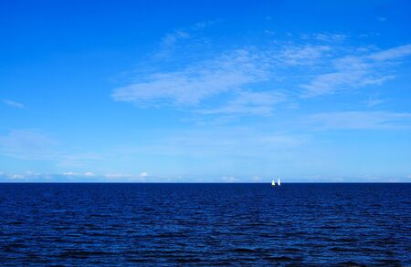 blue sea and sky and small sailboats on it background Imagens