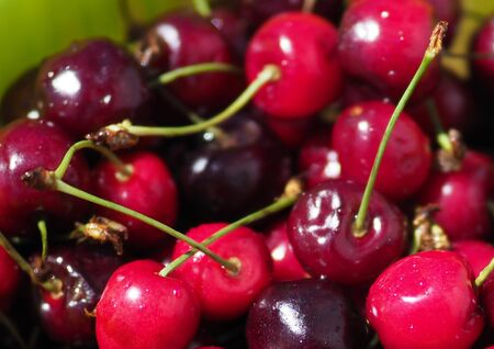 large bowl with ripe cherries summer treat Stock Photo