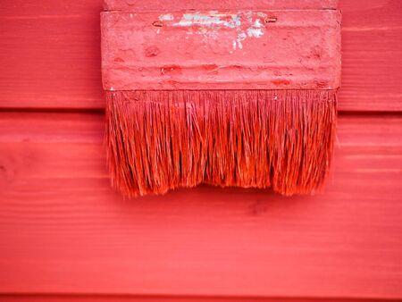 old paint brush on wood background painting Stock Photo
