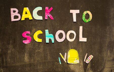 the writing paper back to school on chalk blackboard background Stok Fotoğraf - 131659248