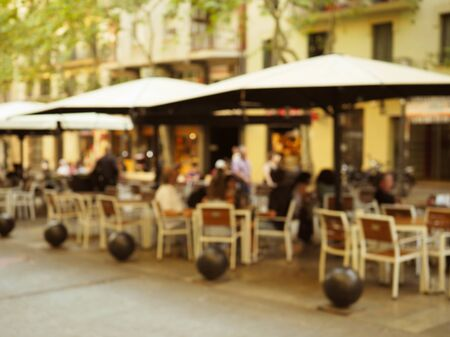 blurred image of the city streets, cafes, people