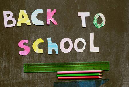 the writing paper back to school on chalk blackboard background Stok Fotoğraf - 131658232