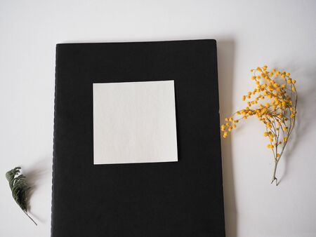 mocap for background stationery. notebooks and pencil and flower are on the table Stok Fotoğraf - 131658366
