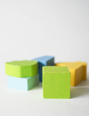 colored children's cubes lie on a white background Stok Fotoğraf - 131658659