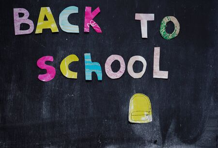the writing paper back to school on chalk blackboard background Stok Fotoğraf - 131658911