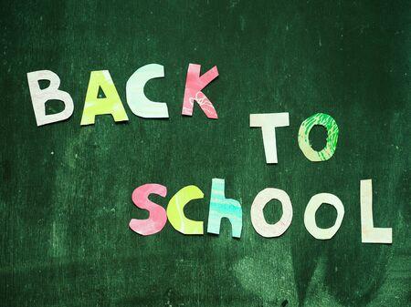 the writing paper back to school on chalk blackboard background Stok Fotoğraf - 131658082