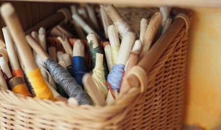 wound multicolored thread for needlework in eco-friendly natural style Stock Photo