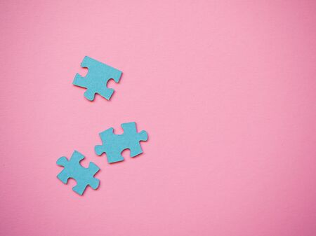 several pieces of the puzzle lie on a solid background Stock fotó