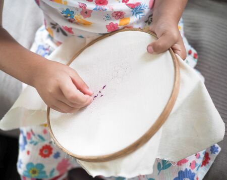 little girl learn to embroider needlework herself