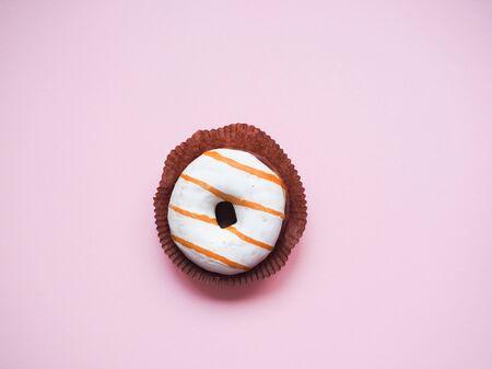 glazed donut lies on a monophonic background Stok Fotoğraf